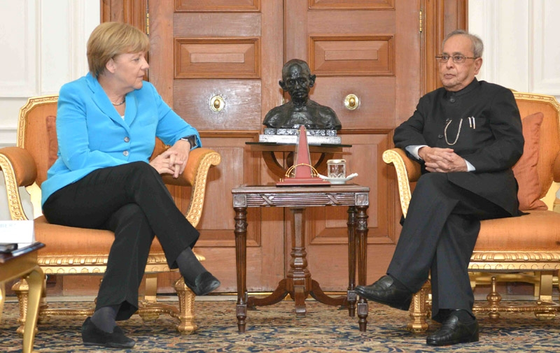 Merkel meets Mukherjee; says both nations need to work together to stabilize world economy