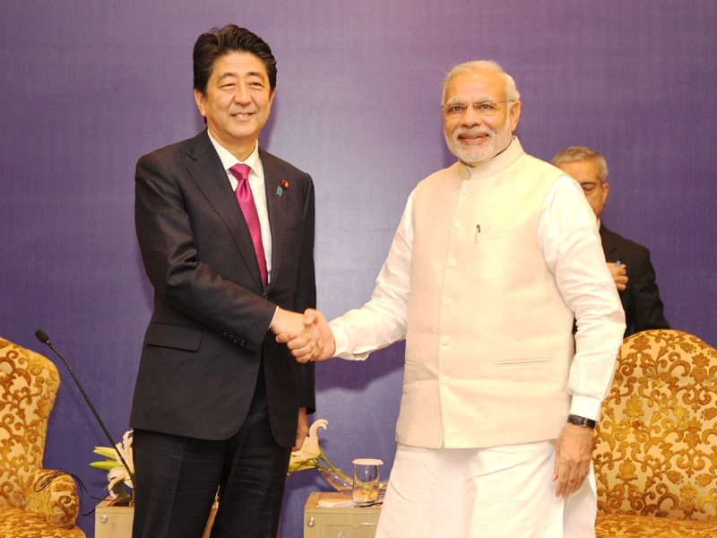 Modi, Abe discuss bilateral ties in Laos