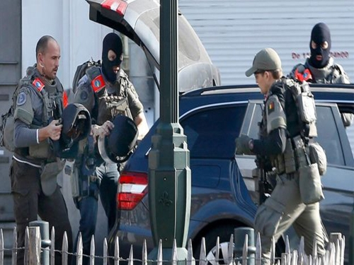 Man shot during Belgian police raids identified as Algerian national; ISIS flag found near his body