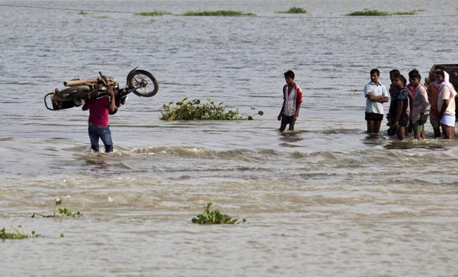 Pre-monsoon floods uproot nearly a lakh in Assam