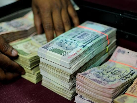 Rupee trades higher at 67.34 against US dollar