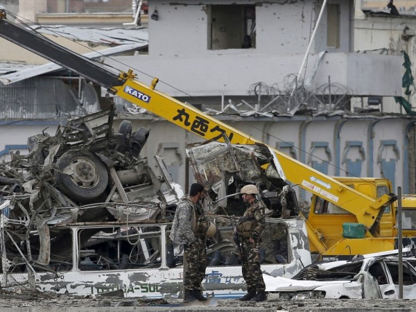 Suicide bomber attacks employee' vehicle in Kabul; around ten dead and four injured