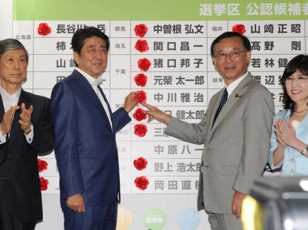Japanese PM Abe's ruling coalition LDP claims a sweeping victory in parliamentary election