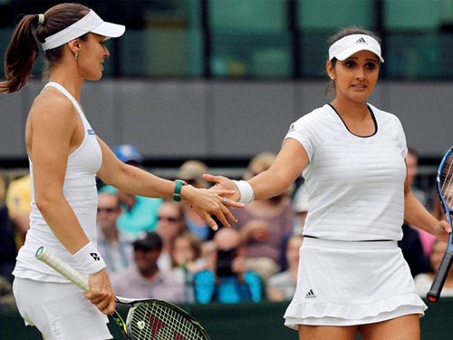 Wimbledon open: Sania Mirza and Marina Hingis enter quarters; Paes advances to third round