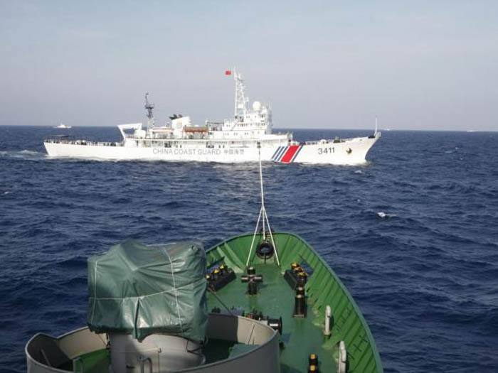 China warns US on security interests in South China Sea