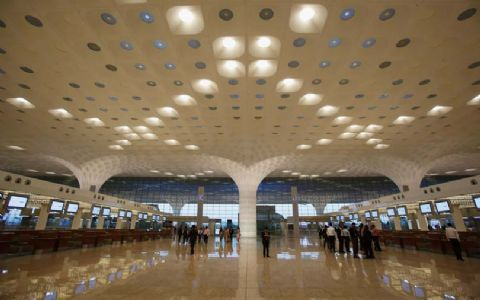 GVK sells 49% stake in airports business to ADIA, NIIF