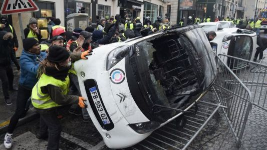 Paris: Yellow Vest protesters attack police with excreta-like substance, torch vehicles