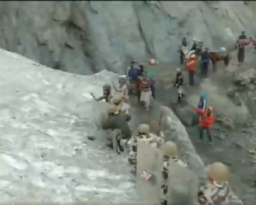 Carefree for own lives but careful for Yatris; ITBP personnel protect Amarnath pilgrims from stones at snow slope